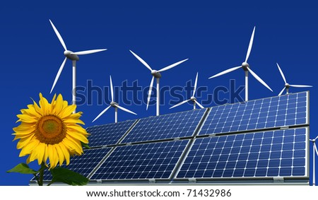 mono-crystalline solar panels, wind turbines and sunflower against a blue background - stock photo