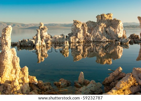 Mono Lake's weird tufa formations at sunrise - stock photo