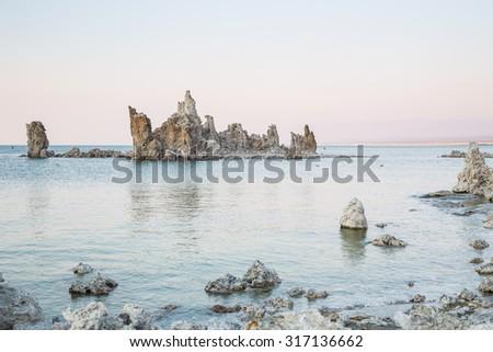 Mono Lake with tufa rock at sunset in Mono County, California, USA - stock photo