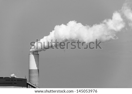 Monochromatic image of Industrial power plant with smokestack. Pollution generated by coal fired power plant.