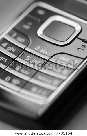 Monochromatic image of the keypad of a cell phone. short depth of field.