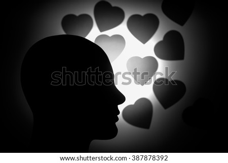 Monochromatic mannequin head against black hearts background