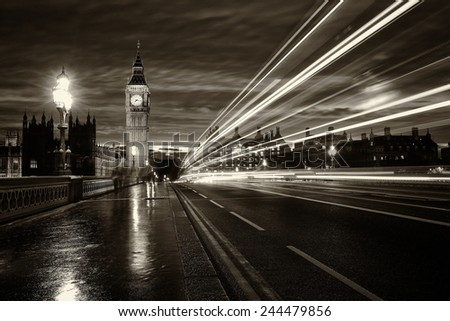 Monochrome Big Ben and London at night with the lights of the cars passing by after rain, London and England