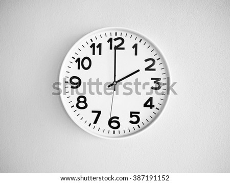 Monochrome clock onthe wall for background - stock photo