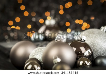 Monochrome Close Up Still Life of Festive Christmas Balls in Variety of Textures and Hues in Selective Focus with Copy Space - stock photo