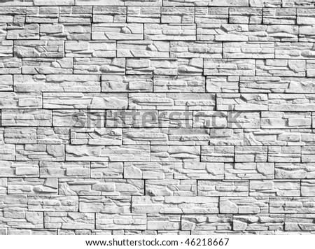 Monochrome decorative stone wall for a background - stock photo