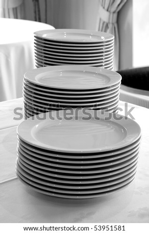 Monochrome group of white plates on a white table