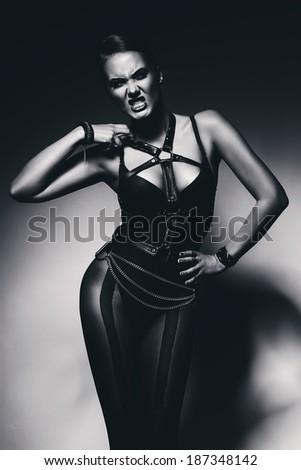 monochrome hot fetish woman in black - stock photo