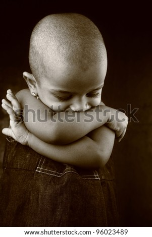Monochrome image of an Indian girl with shaved head - stock photo