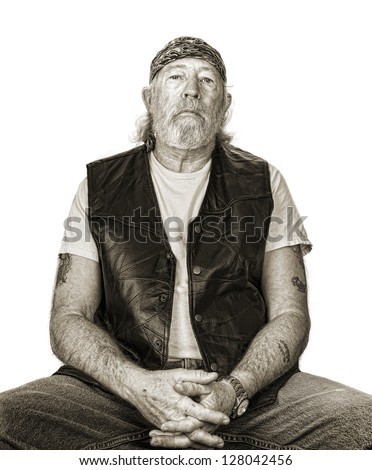 Monochrome of tough old man with sepia toning - stock photo