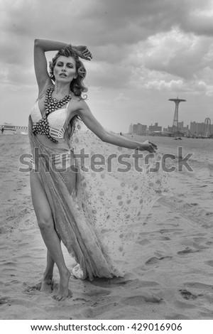 Monochrome photos of model walking at empty beach on Coney Island, Brooklyn NY. - stock photo