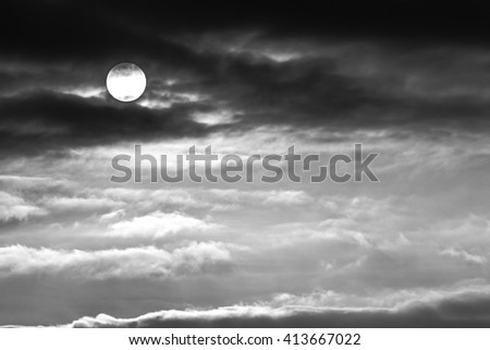 monochrome picture of clouds sky sunset sunrise, black and white - stock photo