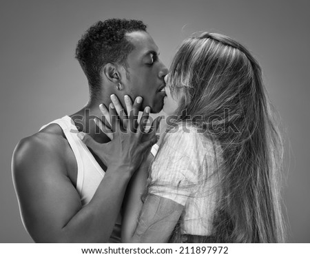 Monochrome portrait of a passionate couple - stock photo