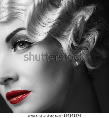 Monochrome portrait of elegant blond retro woman   with beautiful hairdo and red lipstick - stock photo