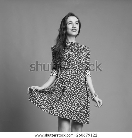 monochrome portrait of happy girl in short dress.beautiful young woman