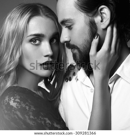 monochrome portrait of lovely couple in tender passion. Beautiful woman near the man.beauty girl and boy together - stock photo