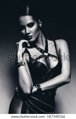 monochrome sexy woman in leather bandage - stock photo