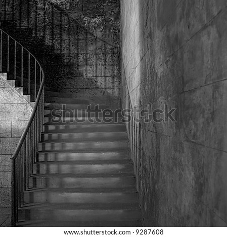 Monochrome shot of sandstone shadowy staircase with rusted handrail (circa 1854) - stock photo
