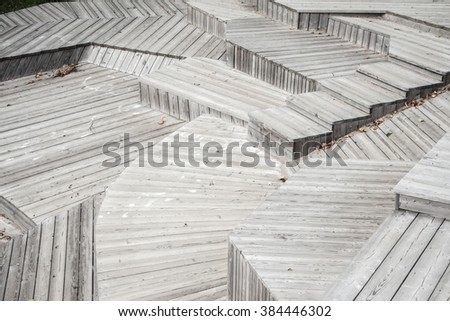 Monochrome striped textured geometric staircase.Pattern line.Gray,grey wooden stripes.Up,down.Contemporary wood tiled stairway.Many different levels,roads,ways,choices, ideas,layers,forms.Nobody - stock photo
