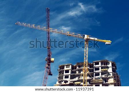 monolithic housebuilding and crane - stock photo