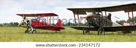monoplane and old biplane - stock photo