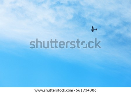 Monoplane in the blue sky