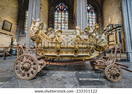 MONS, BELGIUM - JUNE 13, 2014: Waltrude's Shrine Procession within The Ducasse de Mons (Doudou) celebrations, recognized as one of the Masterpieces of the Oral and Intangible Heritage of Humanity. - stock photo