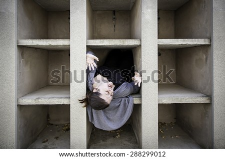 Monster cemetery niches, and fear girl - stock photo