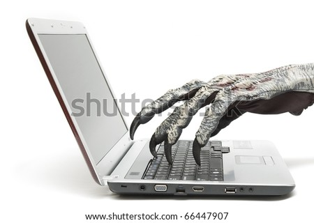 Monster hand is typing on a computer