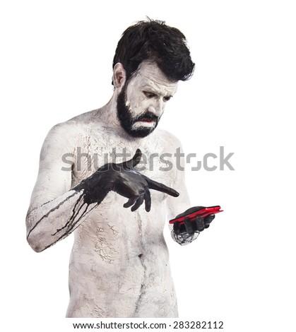 Monster holding phone - stock photo