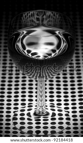 Monster in a glass of water, reflection of dots - stock photo