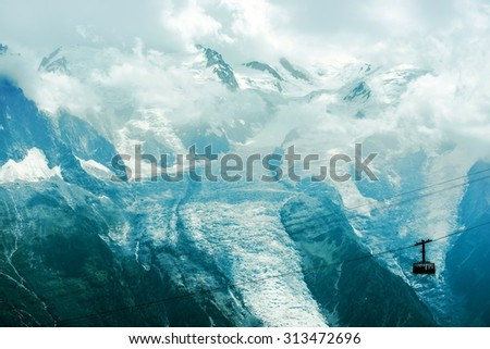 Mont Blanc Alps Massif Glacier and the Cable Car Lift. Chamonix, France, Europe. - stock photo