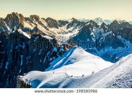 Mont Blanc, Chamonix, French Alps. France. - tourists climbing up the mountain - stock photo