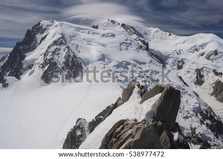 Mont Blanc massif (France) on a clear summer day - summit with an interesting cloud cap