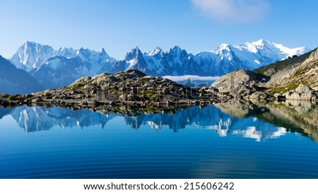 Mont Blanc Massif Reflected in Lac Blanc, Graian Alps, France - stock photo