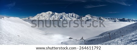 Mont-Blanc massive over clouds, panoramic