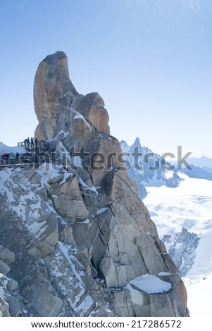 Mont Blanc mountain range, In Chamonix, France, with climbers on its rocks - stock photo