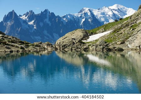 Mont Blanc reflected in Lac Blanc, Mont Blanc Massif, Alps, France - stock photo