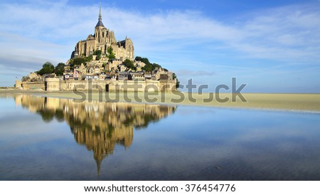 MONT SAINT-MICHEL, FRANCE - AUGUST 12, 2012: Mont Saint Michel abbey. One of France's most recognisable landmarks and its bay are part of the UNESCO list of World Heritage Sites.
