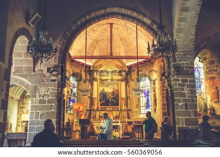 MONT SAINT MICHEL, FRANCE - June 18, 2016: people pray inside the church in Mont Saint Michel abbey, the famous UNESCO world heritage site