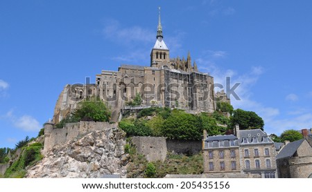 Mont Saint Michel island commune with Abbey and fortifications in Normandy France - stock photo