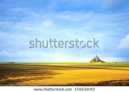 Mont Saint Michel monastery landmark and field. Unesco heritage site. Normandy, France, Europe. - stock photo
