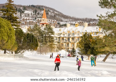 Mont Tremblant, Canada - February 26, 2014: Young People on the ice rink at Tremblant resort. Tremblant is a year-round resort in the Laurentian Mountains of Quebec about 130 km northwest of Montreal. - stock photo