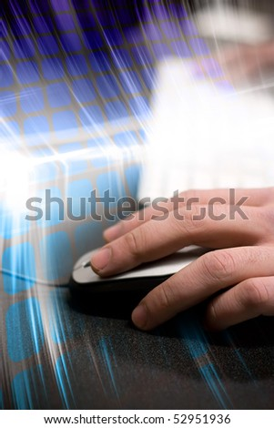 Montage of a hand using a computer mouse with high tech digital effects in the background. - stock photo
