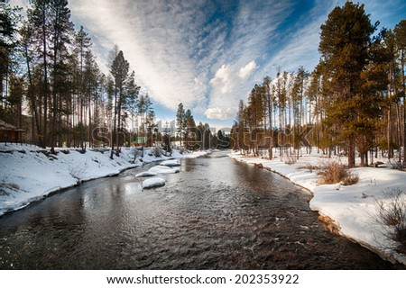 Montana Creek in winter - stock photo