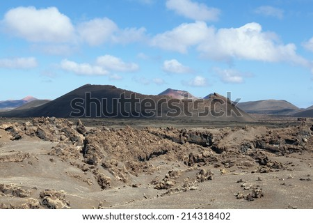 Montana Cuervo; volcanic lava landscape of Lanzarote island, Spain.  The island was hit by a series of volcanic eruptions from 1730 to 1736.   - stock photo