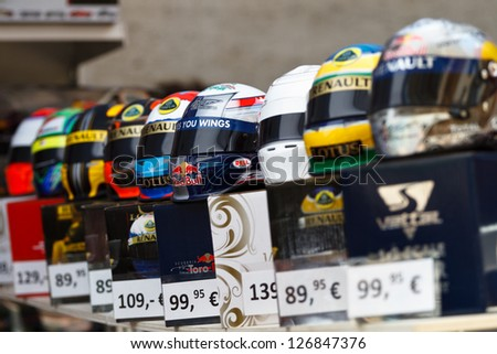 MONTE CARLO - MAY 25: F1 driver's helmet models with their price tags displayed in a merchandise stall during Monaco Formula 1 Grand Prix weekend on May 25, 2012 in Monte Carlo. - stock photo