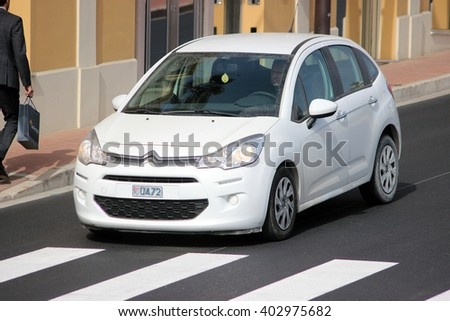 Monte-Carlo, Monaco - April 6, 2016: White Citroen C3 on Avenue d'Ostende in Monaco. Man Driving a French Car in the South of France