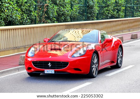 MONTE CARLO, MONACO - AUGUST 2, 2014: Red sports car Ferrari California at the city street. - stock photo
