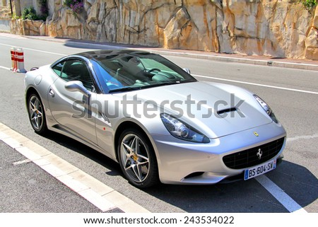 MONTE CARLO, MONACO - AUGUST 2, 2014: Silver sports car Ferrari California at the city street. - stock photo